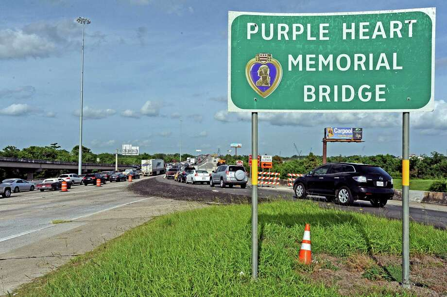 As construction continues on the Purple Heart Memorial Bridge in Beaumont traffic trickles through, but not with a few problems.  With the merging traffic and fast moving vehicles traffic collisions have become quite an issue.  Photo taken Tuesday, June 25, 2013.
