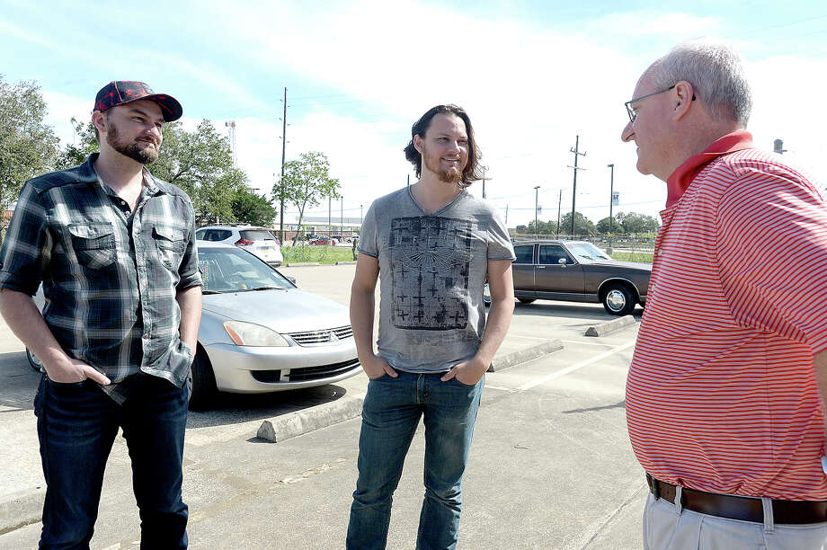 Nederland native Tim Foust (center) and Home Free bandmate Adam Chance greet Dan Maher, Executive Director of the SETX Food Bank, during a stop at the facility to deliver a donation of $15,000 Monday. The money will provide 45,000 meals to those in need. Home Free started a YouCaring fundraising site to aid those in communities throughout Southeast Texas impacted by Tropical Storm Harvey. They have currently raised over $85, 000 of their $100,000 goal. The band, which is currently on its Timeless World Tour, played a show in Lufkin Sunday night, and Foust and Chance decided to take advantage of a free day before heading to Arizona to visit the area and hand deliver some of their donations. Stops Monday included two Orange County schools to whom they have donated materials and instruments to replace those which music students lost to flooding. A large contribution was also made to Nederland Avenue Church of Christ's disaster relief fund to be distributed appropriately to various other schools and victims of Harvey. Photo taken Monday, October 16, 2017 Kim Brent/The Enterprise Photo: Kim Brent / BEN