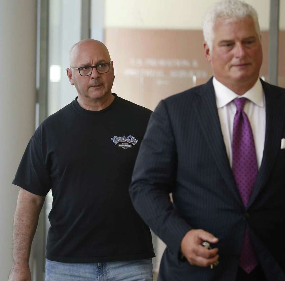 Louis P. Ciminelli, left, gets escorted out of court with his attorney Daniel C. Oliverio, right, after facing charges of  rigging and bribery at Buffalo federal court on Thursday, Sept. 22, 2016.  (Robert Kirkham/Buffalo News) Photo: Robert Kirkham / Copyright 2016, The Buffalo News