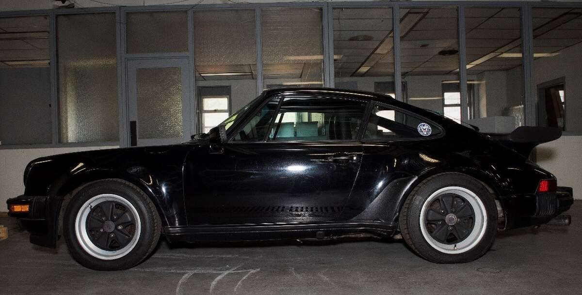 This 1986 Porsche 911 Turbo Carrera seized by the state Department of Motor Vehicles will be auctioned off by the state on Nov. 8 at the Harriman State Office Campus in Albany, N.Y.