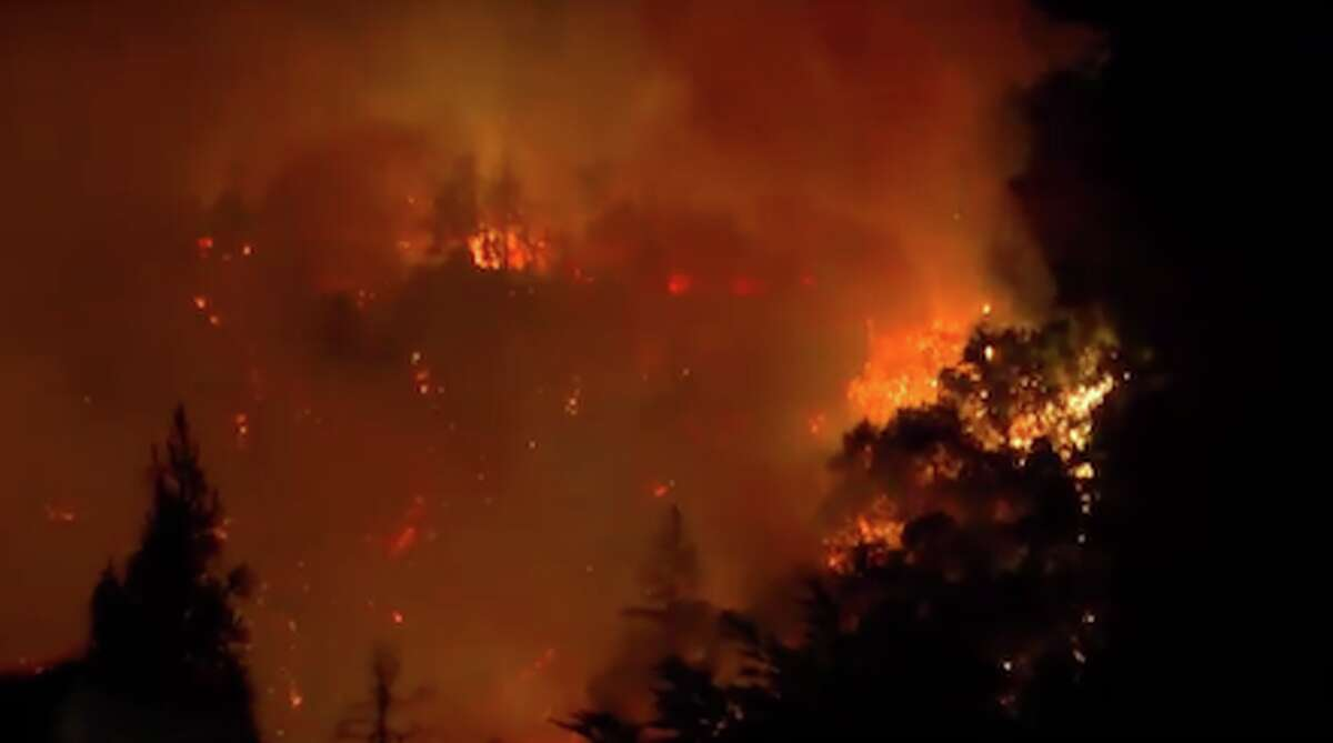 A new wildfire that started Monday night in the Santa Cruz Mountains has injured two firefighters and prompted evacuations in the area around Boulder Creek, according to fire officials.