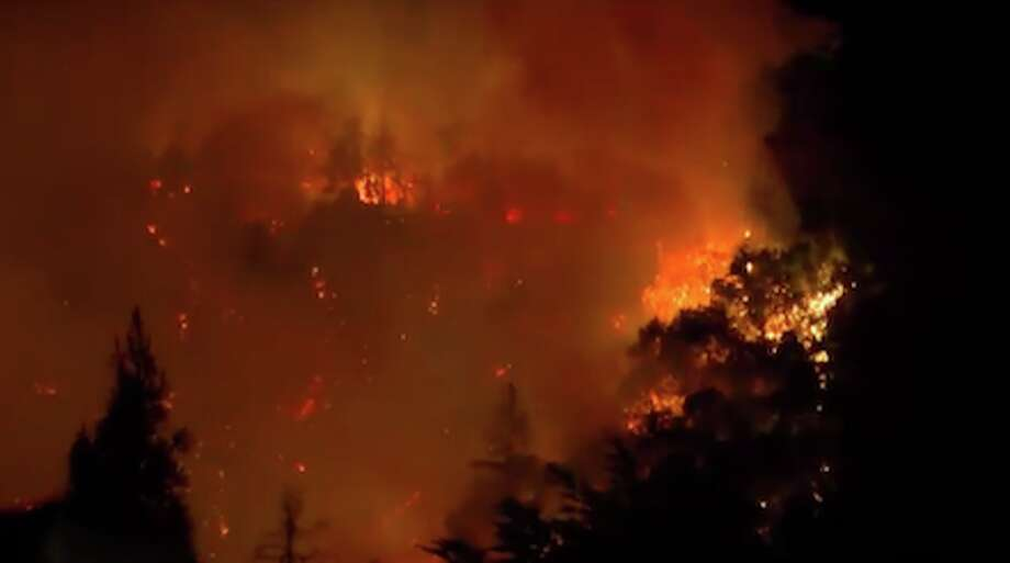 A new wildfire that started Monday night in the Santa Cruz Mountains has injured two firefighters and prompted evacuations in the area around Boulder Creek, according to fire officials. Photo: KTVU/ Twitter
