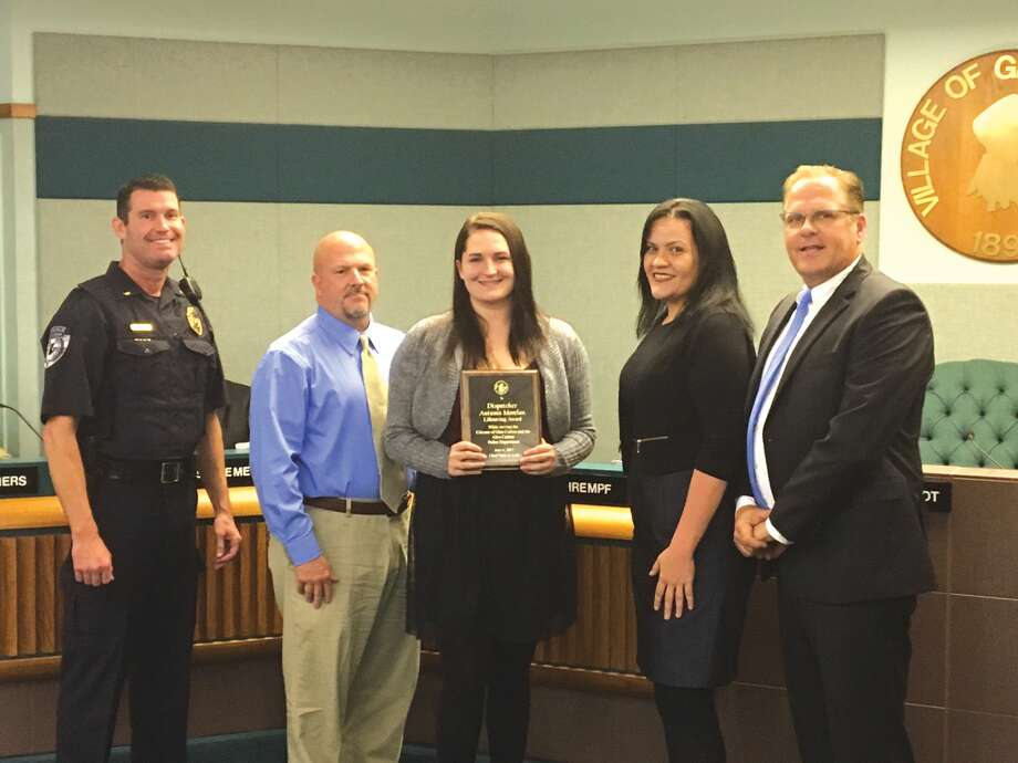 Glen Carbon Telecommunicator Autumn Morelan (center) received the Life Saving Award for her dispatch work during a potentially deadly house fire. Also pictured, from left, is Glen Carbon Police Lt. Wayne White, Morelan's father retired Granite City Police Lt. Jon Blaylock,  Glen Carbon Police Support Service Supervisor Coleen Schaller and Glen Carbon Mayor Rob Jackstadt. Photo: John Sommerhof • Jsommerhof@edwpub.net