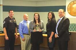 Glen Carbon Telecommunicator Autumn Morelan (center) received the Life Saving Award for her dispatch work during a potentially deadly house fire. Also pictured, from left, is Glen Carbon Police Lt. Wayne White, Morelan's father retired Granite City Police Lt. Jon Blaylock,  Glen Carbon Police Support Service Supervisor Coleen Schaller and Glen Carbon Mayor Rob Jackstadt.