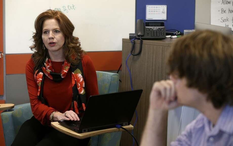 CAST Tech High School principal Melissa Alcala (left) works with school teachers Monday October 16, 2017. CAST Tech, The Centers for Applied Science and Technology, is located downtown on the Fox Tech campus and has college coursework embedded in its programs allowing some students to graduate with an associate's degree, industry certifications and portfolios with examples of their work. Photo: John Davenport, STAFF / San Antonio Express-News / ©John Davenport/San Antonio Express-News