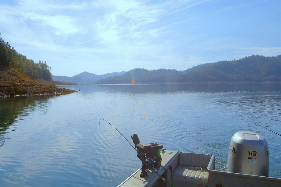 Blue-sky day this week trolling for big rainbow trout at Shasta Lake, the state's largest reservoir with 365 miles of shoreline. Shasta Lake�is entering fall and winter at 72 percent full, the highest water levels for mid-October in 10 years. Photo: Tom Stienstra, Tom Stienstra / The Chronicle