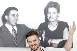 Owner and Chef Ryan Durant , with a photo featuring his inspirational grand parents, in his Assagio restaurant in Branford with the restaurant's risotto with blackened Chilean sea bass and picked lobster meat. Ingredients include Chilean sea bass, lobster meat, arborio rice, shallots, cream, butter, parmigiana cheese, red sauce, basil, and seafood stock, (for substitute can use : clam juice).