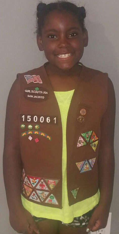 Kailei McGowan grabbed her Girl Scout vest before her family was forced to leave its flooded Richmond apartment. Photo: Ashlei Gill
