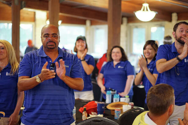 Employees of The Lighthouse of Houston applaud as the donation amount is announced from theNorthwest Petroleum's second annual Charity Classic Golf Tournament.