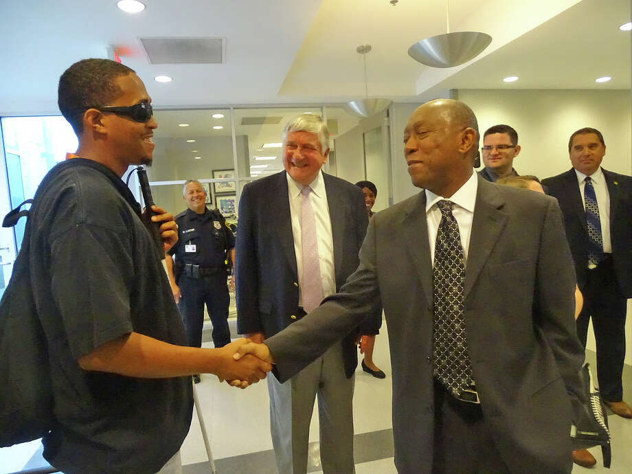 Houston Mayor Sylvester Turner meets with Lighthouse client Mikey Fields, as Lighthouse President Gibson DuTerroil looks on. Photo: Courtesy Photo