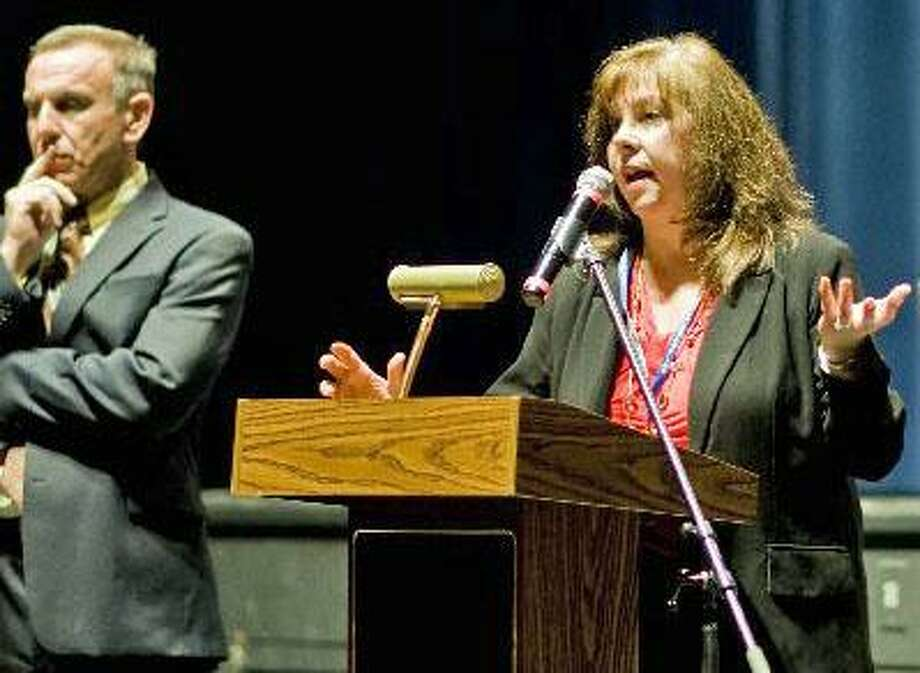 Lorrie Rodrigue, interim superintendent of Newtown schools, and former superintendent Joseph Erardi Photo: / Scott Mullin
