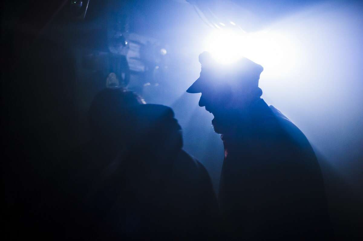 A man dressed as a naval captain yells at people as they walk through the Edson Incident, a haunted attraction which leads visitors through 5 levels of a Vietnam era U.S. Navy Destroyer, on Saturday, Oct. 14, 2017 in Bay City. (Katy Kildee/kkildee@mdn.net)