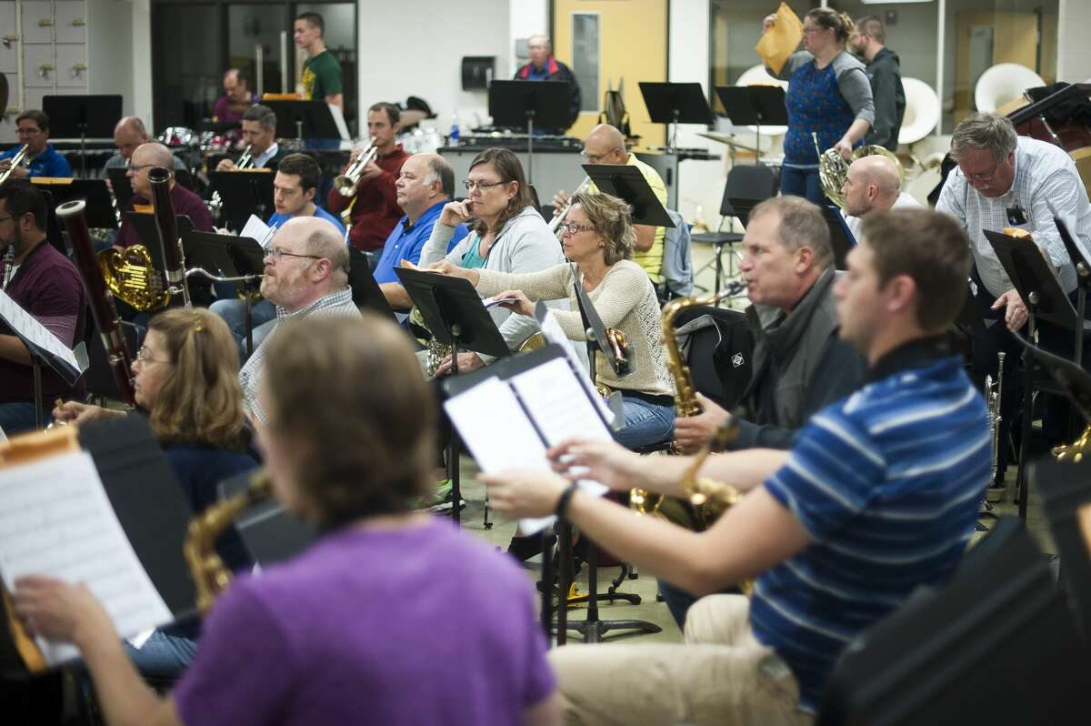 Members of the Midland Concert Band prepare to begin a rehearsal on Thursday, Oct. 12, 2017 at H. H. Dow High School. (Katy Kildee/kkildee@mdn.net)