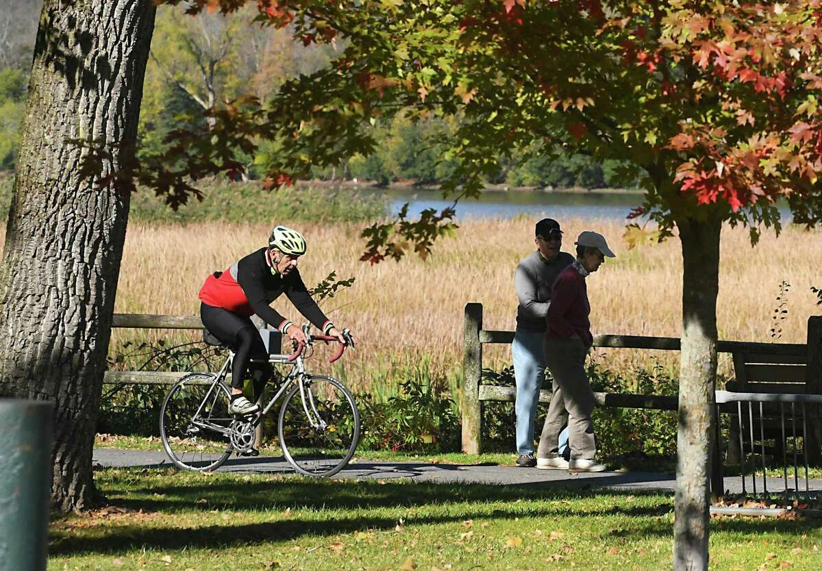 Pedestrians walking on the Mohawk Hudson Bike/Hike Trail move over for a bicyclist on Tuesday, Oct 17, 2017 in Niskayuna, N.Y. (Lori Van Buren / Times Union)