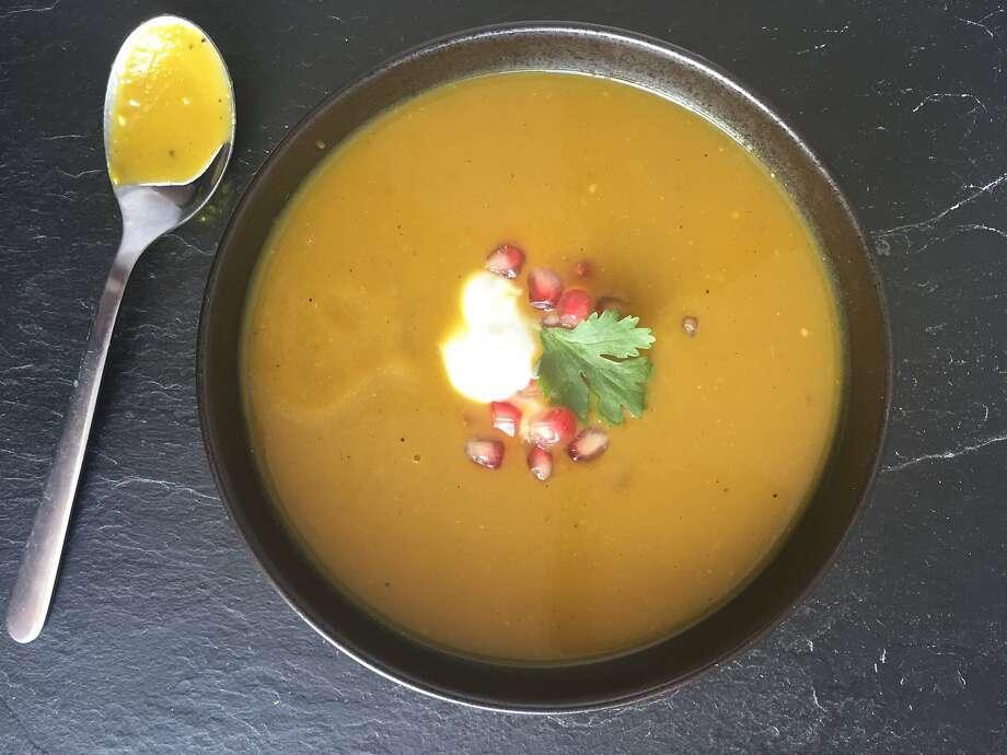 Garam masala-spiced pumpkin soup with yogurt & pomegranate seeds. Photo: Sarah Fritsche