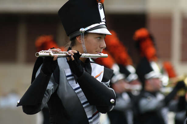 """Katelyn Kocurek and the Bridgeland High School Marching Band performs during the third annual """"Battle at the Berry"""" Marching Invitational at the Cy-Fair FCU on Oct. 14, 2017. (Photo by Jerry Baker/Freelance)"""
