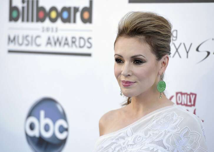 """FILE - In this May 19, 2013, file photo, Alyssa Milano arrives at the Billboard Music Awards at the MGM Grand Garden Arena in Las Vegas. Thousands of women responded to Milano's call on Sunday, Oct. 16, 2017, to tweet """"me too"""" in order to raise awareness of sexual harassment and assault following the recent revelation of decades of allegations of sexual misconduct by movie mogul Harvey Weinstein. (Photo by John Shearer/Invision/AP, File)"""