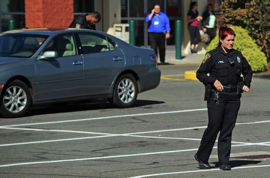Norwalk police secure the area in and around the P.C. Richards and Son and Dick's Sporting Goods stores at 444 Connecticut Ave. after arresting a man with a BB gun Tuesday, October 17, 2017, in Norwalk, Conn. Photo: Erik Trautmann / Hearst Connecticut Media / Norwalk Hour