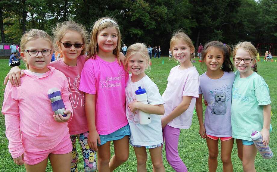 Holmes School second-graders Anna Farmer, Samantha Ludlow, Catherine Parent, Lilly Edgar, Samantha Heins, Brooke Moyers, Eleanor Lubeley hang out at the fourth annual walkathon Sept. 29. Photo: Contributed Photo