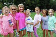 Holmes School second-graders Anna Farmer, Samantha Ludlow, Catherine Parent, Lilly Edgar, Samantha Heins, Brooke Moyers, Eleanor Lubeley hang out at the fourth annual walkathon Sept. 29.