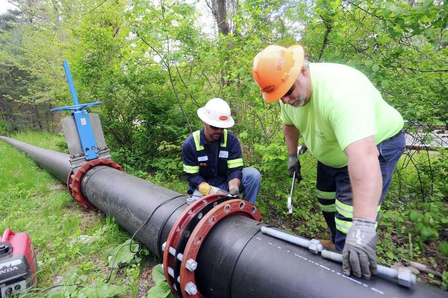 A construction crew dismantles in May 2017 piping that funneled potable water to Stamford, Conn. from an Aquarion reservoir in Bridgeport, during a 2016 drought. On Oct. 15, the Connecticut Public Utilities Regulatory Authority signaled its intent to approve Aquarion's $1.6 billion sale to Eversource Energy. Photo: Michael Cummo / Hearst Connecticut Media / Stamford Advocate