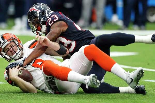 Houston Texans free safety Kurtis Drummond (23) sacks Cleveland Browns quarterback Kevin Hogan (8) during the fourth quarter of an NFL football game at NRG Stadium on Sunday, Oct. 15, 2017, in Houston. ( Brett Coomer / Houston Chronicle )