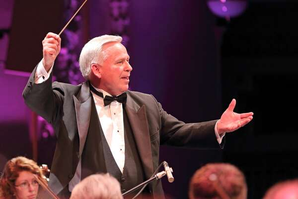 Dr. Craig Jessop, guest conductor and clinician for the inaugural Clay R. Warren Memorial Music Symposium is show with baton in hand. He is the former conductor of the Mormon Tabernacle Choir and U.S. Air Force Singing Sergeants
