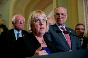 """Sen. Patty Murray, D-Wash., accompanied by Sen. Bernie Sanders, I-Vt., left, and Senate Minority Leader Sen. Chuck Schumer of N.Y., right, speaks to reporters on Capitol Hill in Washington, Tuesday, Oct. 17, 2017, after she and Sen. Lamar Alexander, R-Tenn., say they have the """"basic outlines"""" of a bipartisan deal to resume payments to health insurers that President Donald Trump has blocked."""
