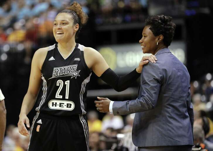 In this July 12, 2017, file photo, San Antonio Stars' Kayla McBride laughs with head coach Vickie Johnson during the second half of a WNBA basketball game against the Indiana Fever, in Indianapolis. The WNBA says the San Antonio Stars are being bought by MGM Resorts International and moving to Las Vegas, joining the NFL and NHL with teams tied to the gambling mecca. The Stars will begin play next season with home games at the Mandalay Bay Events Center.