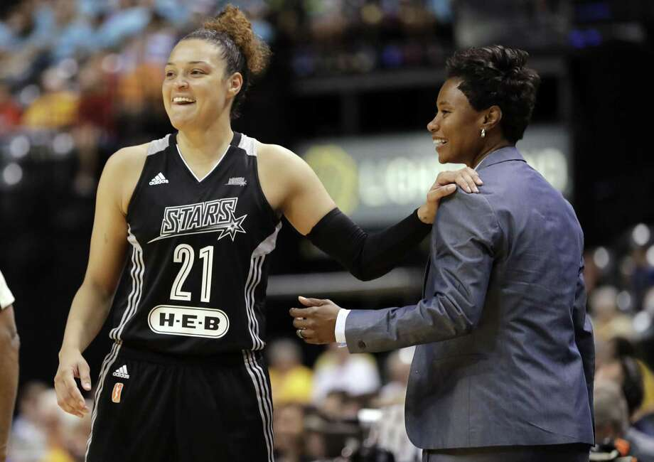 In this July 12, 2017, file photo, San Antonio Stars' Kayla McBride laughs with head coach Vickie Johnson during the second half of a WNBA basketball game against the Indiana Fever, in Indianapolis. The WNBA says the San Antonio Stars are being bought by MGM Resorts International and moving to Las Vegas, joining the NFL and NHL with teams tied to the gambling mecca. The Stars will begin play next season with home games at the Mandalay Bay Events Center. Photo: Darron Cummings /Associated Press / Copyright 2017 The Associated Press. All rights reserved.