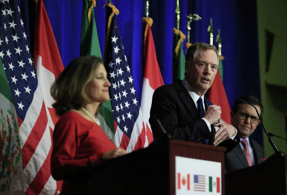 United States Trade Representative Robert Lighthizer (center), with Canadian Minister of Foreign Affairs Chrystia Freeland and Mexico's Secretary of Economy Ildefonso Guajardo Villarrea, speaks during the conclusion of the fourth round of negotiations for a new North American Free Trade Agreement in Washington on Tuesday. Photo: Manuel Balce Ceneta /Associated Press / Copyright 2017 The Associated Press. All rights reserved.