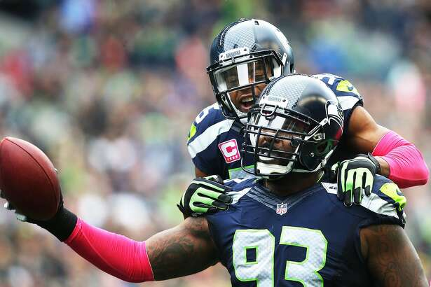 Seahawks player DeShawn Shead celebrates with Seahawks defensive lineman Tony McDaniel after McDaniel secured a fumble dropped by Falcons quarterback Matt Ryan in the first half of the Seahawks game against Atlanta, Sunday Oct. 16, 2016, at CenturyLink Field. (Genna Martin, seattlepi.com)
