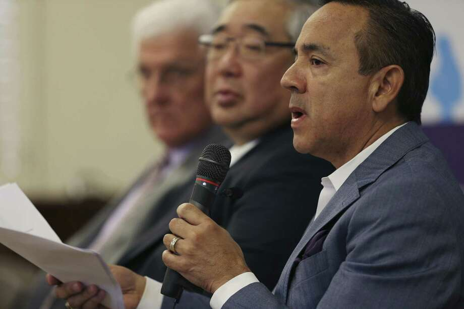 File photo of Texas Senator Carlos Uresti (right), Bexar County district court Judge Peter Sakai (middle) and former commissioner with the Texas Department of Family and Protective Service John Specia. Uresti has listed Sakai and Specia as potential witnesses in his upcoming criminal fraud trial, which starts Monday and may stretch three weeks. Photo: JERRY LARA /San Antonio Express-News / © 2016 San Antonio Express-News