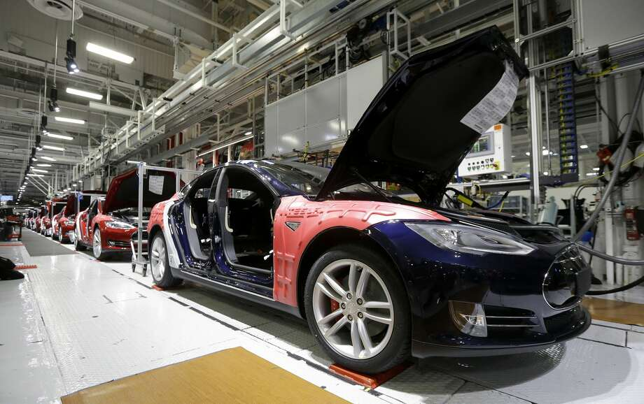 FILE - In this May 14, 2015, file photo, Tesla Model S cars are shown in the Tesla factory in Fremont, Calif. Tesla's second-quarter deliveries surged 52 percent to set a company record exceeding 11,000 vehicles, the electric car maker said Thursday, July 2, 2015. (AP Photo/Jeff Chiu, File) Photo: Jeff Chiu/AP