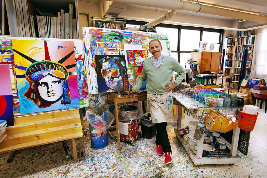 Peter Max, posing in his art studio, will appear at C. Parker Gallery on Greenwich Avenue Saturday and Sunday. Photo: © Peter Max 2017 /Contributed Photo / ©2013 Brad Trent