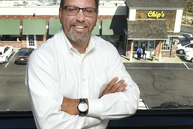 Anthony Cuozzo, recently retired Orange assistant  police chief, is  starting his new career as chief operating officer of Chip's Family Restaurants. Here he is in his corporate office  in Orange.