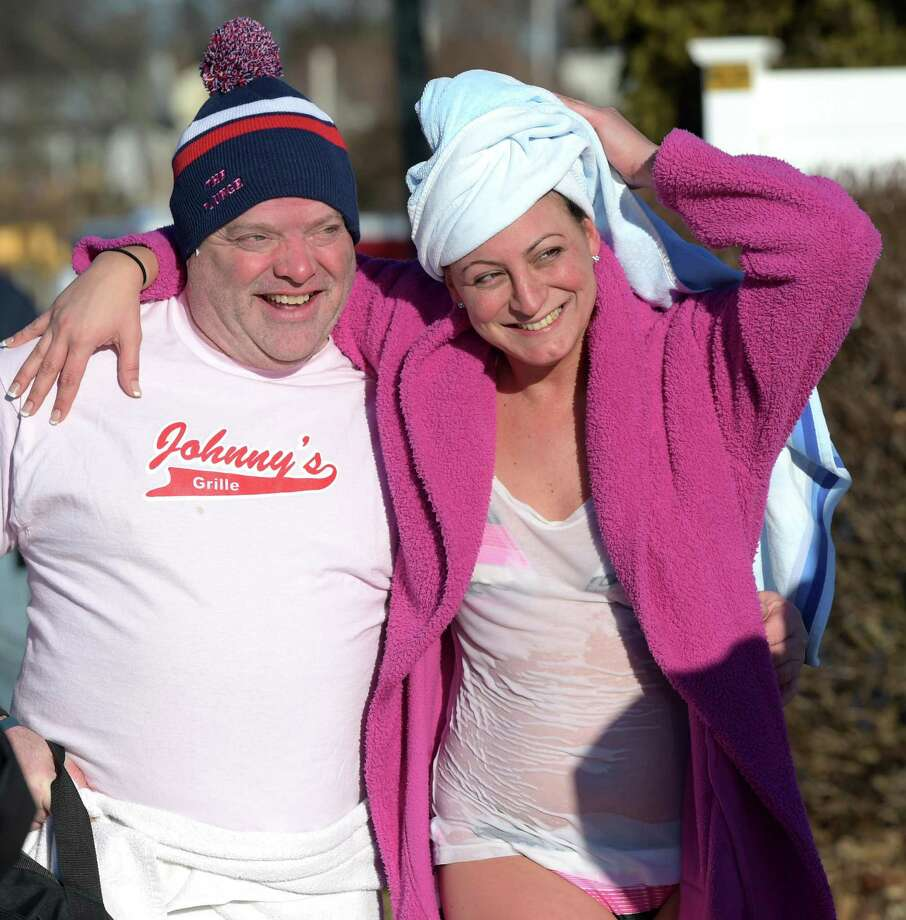 Michael Richetelli and friend Dana Fiamini hug after diving into the frigid Long Island Sound in West Haven, Conn., for the 15th Annual Icy Plunge for the Cure, a fundraiser benefiting breast cancer research. Photo: /©2015 Peter Hvizdak / ©2015 Peter Hvizdak