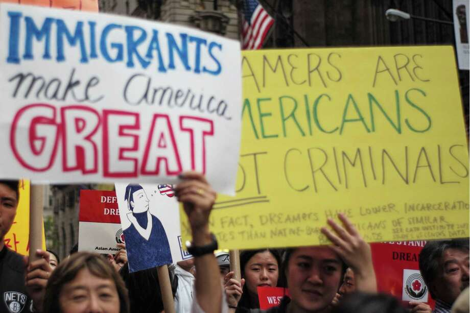 Protesters hold up signs during a demonstration against President Donald Trump during a rally in support of the Deferred Action for Childhood Arrivals (DACA), also known as Dream Act, near the Trump Tower in New York on October 5. Trump has made restrictionist demands in exchange for his support of new Dreamer legislation. Photo: JEWEL SAMAD /AFP /Getty Images / AFP or licensors