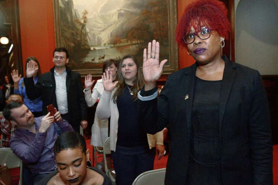 Branford resident and Trinidad and Tobago native, Michelle Welsh, right, participates in the swearing-in during a Special Naturalization Ceremony Tuesday, Oct. 17, at the Lockwood-Mathews Mansion Museum in Norwalk. Photo: Erik Trautmann / Hearst Connecticut Media / Norwalk Hour