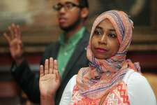 Middletown resident and Moroccan native, Sanaa Bouthi, participates in the swearing-in as part of a Special Naturalization Ceremony Tuesday, October 17, 2017, at the Lockwood Mathews Mansion Museum in Norwalk, Conn.