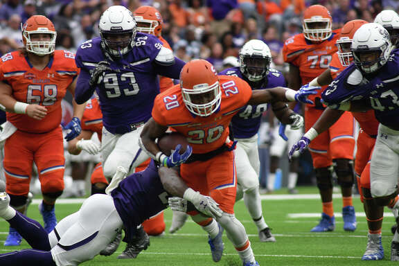 Sam Houston State running back Jordan Brown (20) pushes for extra yards against the Stephen F. Austin defense in the 1st quarter of their Battle of the Piney Woods clash at NRG Stadium in Houston on Saturday, Oct. 7, 2017. (Photo by Jerry Baker/Freelance)