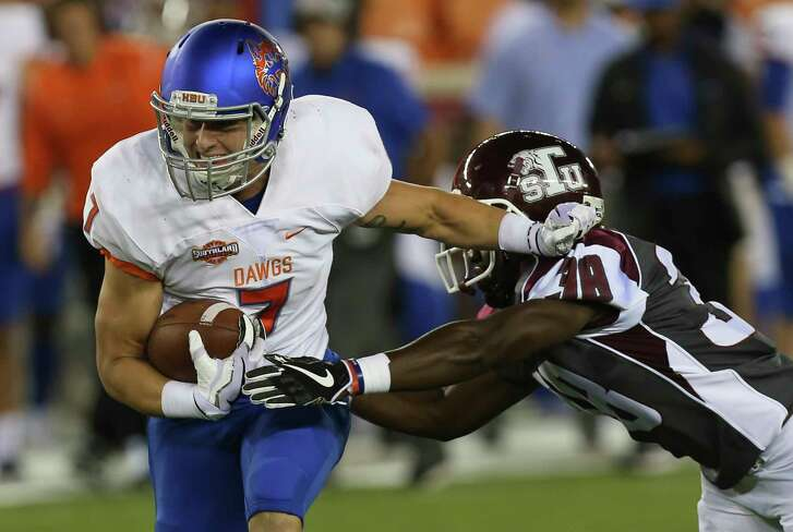 Houston Baptist Huskies wide receiver Ethan Fry (7) is tackled by Texas Southern Tigers defensive back Eric Townsend (18) during the first quarter of the game at BBVA Compass Stadium Thursday, Sept. 7, 2017, in Houston. ( Yi-Chin Lee / Houston Chronicle )