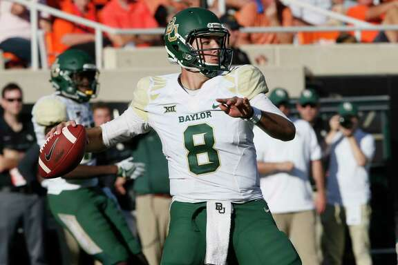 Baylor quarterback Zach Smith passes int he third quarter of an NCAA college football game against Oklahoma State in Stillwater, Okla., Saturday, Oct. 14, 2017. Oklahoma State won 59-16. (AP Photo/Sue Ogrocki)