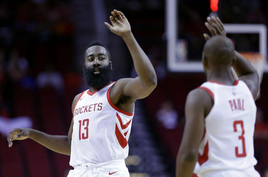 Houston Rockets guard James Harden (13) and Chris Paul (3 )high five in the first half of an NBA exhibition basketball game against the Shanghai Sharks Thursday, Oct. 5, 2017, in Houston. (AP Photo/Michael Wyke) Photo: Michael Wyke, Associated Press