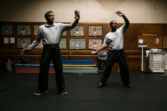 Bill Owens, left, and Jerome Luckett practices their techniques before the start of class at the Cascos Martial Arts Academy in Oakland, Calif. Tuesday, October 17, 2017.