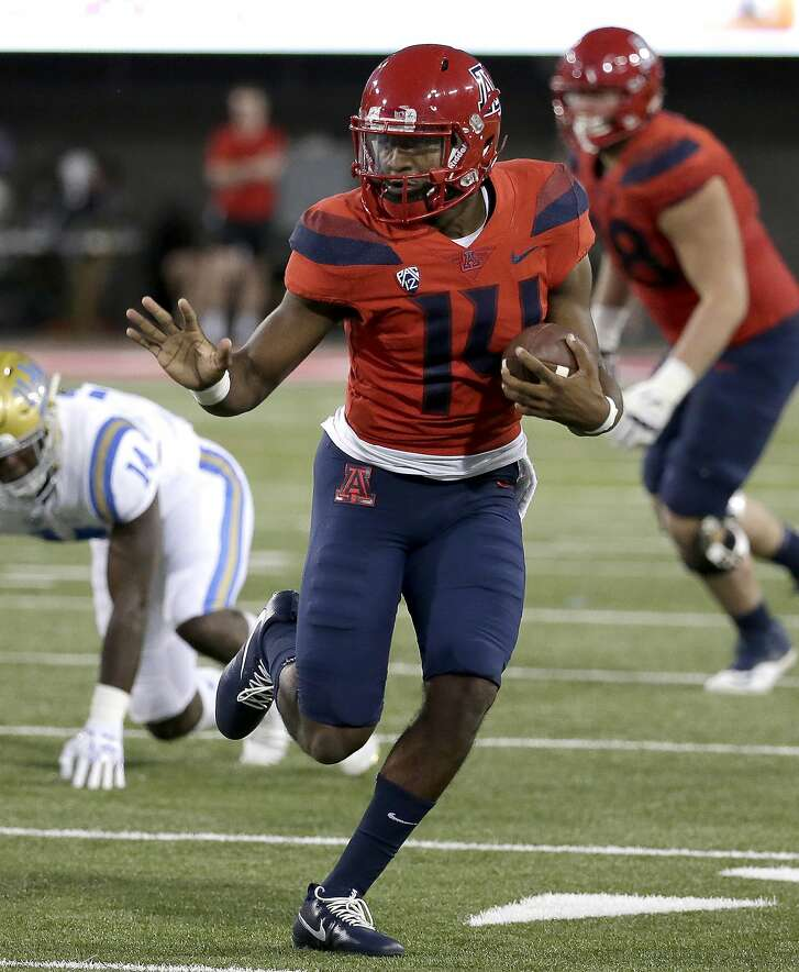 Arizona quarterback Khalil Tate (14) in the first half during an NCAA college football game against UCLA, Saturday, Oct. 14, 2017, in Tucson, Ariz. (AP Photo/Rick Scuteri)