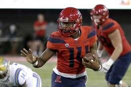 Arizona quarterback Khalil Tate (14) in the first half during an NCAA college football game against UCLA, Saturday, Oct. 14, 2017, in Tucson, Ariz. (AP Photo/Rick Scuteri)