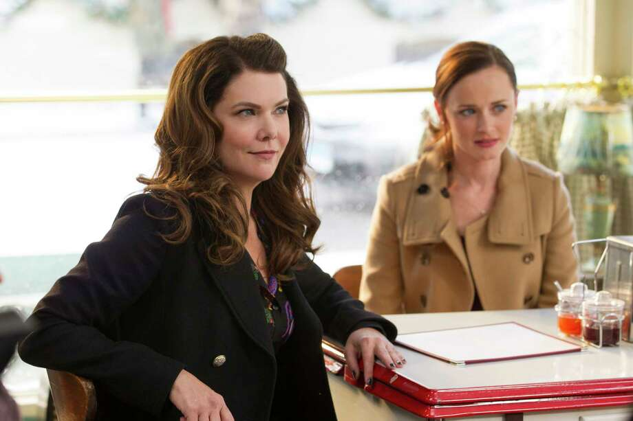 "This image released by Netflix shows Lauren Graham, left, and Alexis Bledel in a scene from, ""Gilmore Girls: A Year In The Life,"" currently streaming on Netflix. The ""Gilmore Girls: A Year in the Life"" series currently holds the top spot for binge racing, Netflix says. It's followed by ""Fuller House,"" ""The Ranch,"" ""Marvel's The Defenders"" and ""The Seven Deadly Sins."" Binge racers are fans who plow through a streaming-network series' entire season in less than 24 hours after the release of all those episodes. (Saeed Adyani/Netflix via AP) ORG XMIT: NYET701 Photo: Saeed Adyani / Netflix"