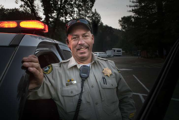 Deputy Mark Aldridge, who saved 35 people at this parking lot during the fire, pose on Tuesday, Oct. 17, 2017 in Santa Rosa, CA.