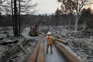 Rick Dunham walks where his garage and workshop once stood on Monday, Oct. 16, 2017 in Glen Ellen, CA.